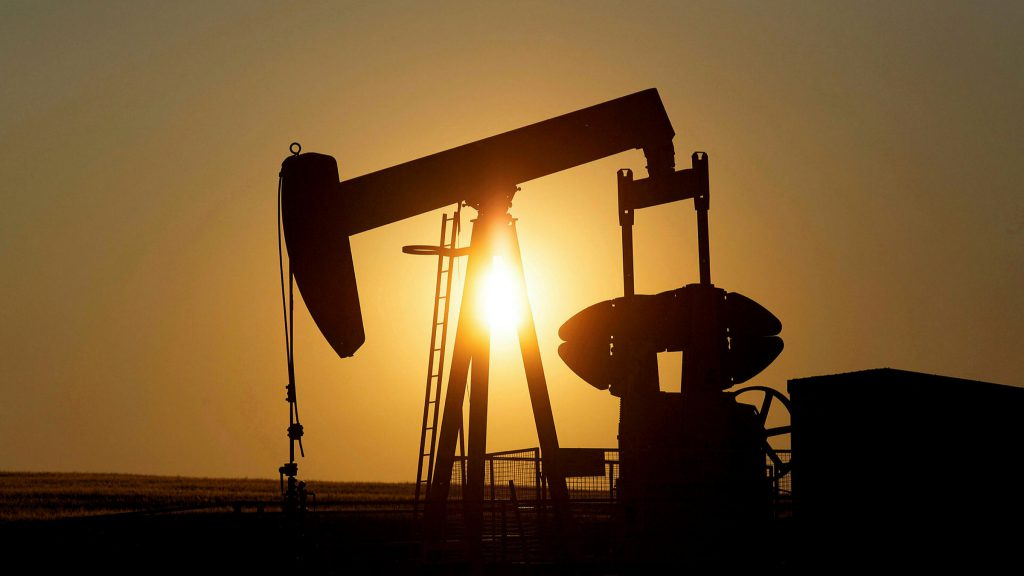 Oil gains as U.S. production slowly returns after freeze